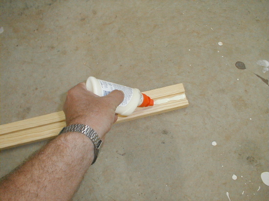 'honey bee hive bottom board - glueing side rail' from the web at 'http://www.bees-and-beekeeping.com/images/honey-bee-hive-bottom-board-3.jpg'