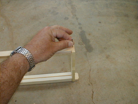 honey bee hive frame assembly - nailing bottom bar